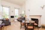 Living and dining area with stunning views over the Royal Crescent and Victoria Park