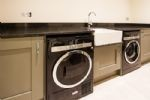 Large utility room with washing machine and separate tumble dryer