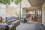 Social open plan living with central courtyard through to kitchen and dining