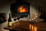 Enjoy a glass of wine around the real wood burning fire