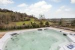 Enjoy a 12 seater hot tub with incredible views